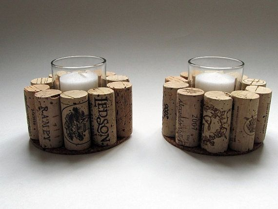Wine corks have been secured around a glass votive candle holder and left unadorned. Simple yet elegant, these will make a wonderful addition to your next dinner party or gathering. The set comes with 2 unscented white votive candles to complete the look.  Corks are upcycled and all natural. The corks used may vary but will always contain a good variety.  Have a look at all our wonderful Wine Cork items: http://www.etsy.com/shop/LizzieJoeDesigns and be sure to check out our gift sections…