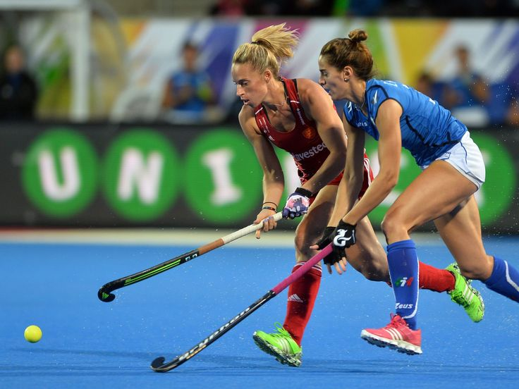 England's Susannah Townsend, left, fights for control of the ball with Italy's Marcela Casale during the EuroHockey women's match in London.  Hannah Mckay, EPA