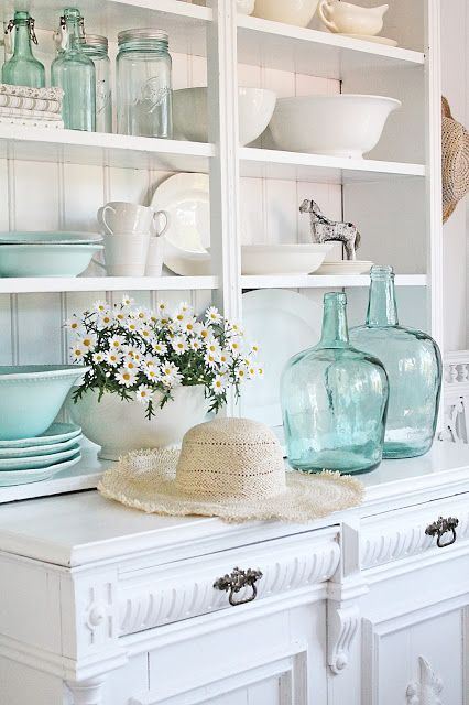 Aqua accents adds a touch of color to a beautiful room.