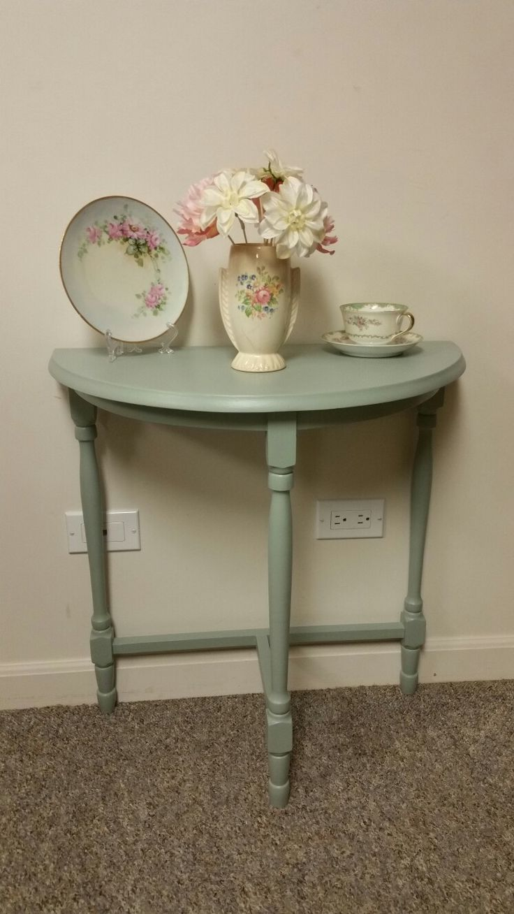 Very pretty after photo of the half moon table that was brown and sad. Done by It's Flippin Vintage
