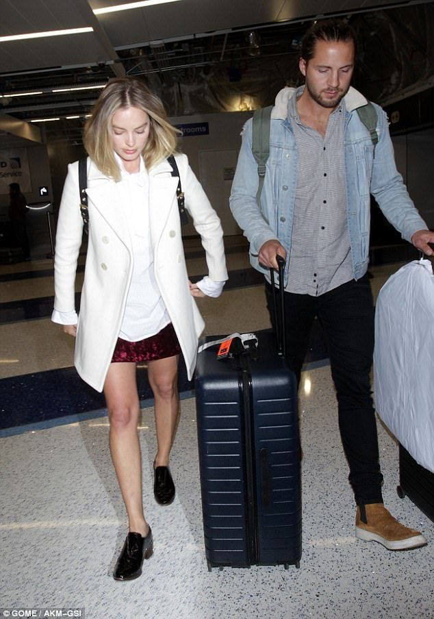 Jet-setter: After attending the Time 100 Gala in New York City on Tuesday, Margot Robbie flew into Los Angeles on Wednesday with husband Tom Ackerley