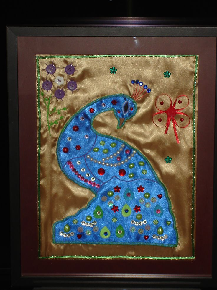made a peacock frame using satin cloth and beads