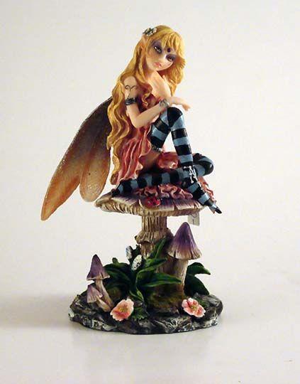 A fairy sits on a mushroom  Size: 17,5 cm