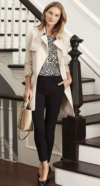 Relaxed light tan trench, black and white cheetah print top, blank ankle skinny trousers, black heels, and light tan bag