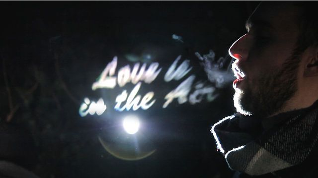 Love is in the Air by Wriggles & Robins. A short love story back projected into the warm breath of a couple on a cold February evening.