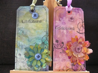 Two tags made with ecoline, glimmermist, gesso