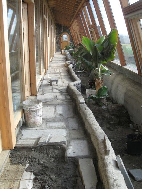 An earthship inspired front greenhouse wall.