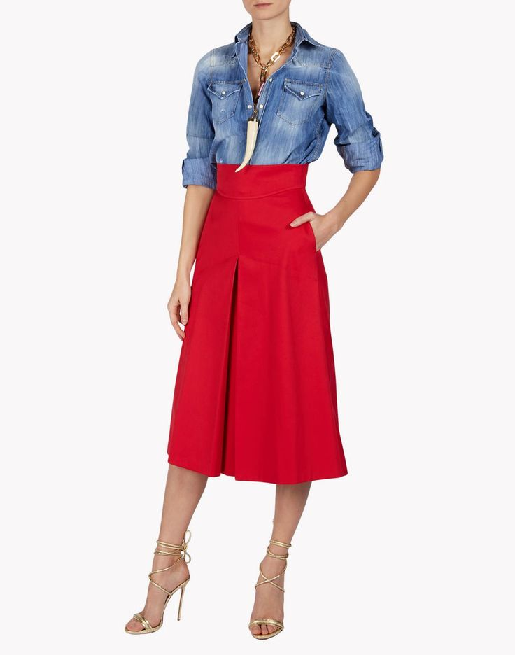 First appearances are demure and ladylike, but this skirt's front pleat, nipped-in high waist and scarlet color takes a sultry tone when paired with a shirt and gold ankle strap sandals.