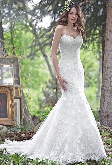 Maggie Sottero. See more details from Maggie Sottero��Elegant and timeless fit-and-flare wedding dress features embroidered lace on tulle and a romantic, scalloped lace sweetheart neckline. Finished with corset closure.