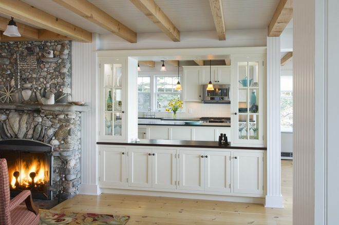 A pass-through can also provide extra storage on the dining or family room side. Consider shallow lower cabinets for tall glasses and linens.