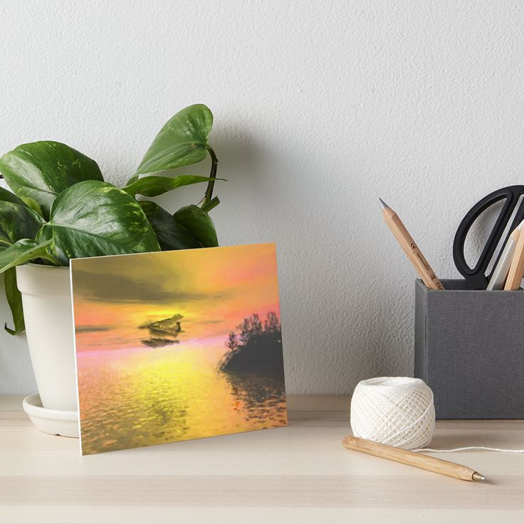 A seaplane flying past a lightly treed outcrop at sunset. • Also buy this artwork on wall prints, apparel, phone cases, and more.