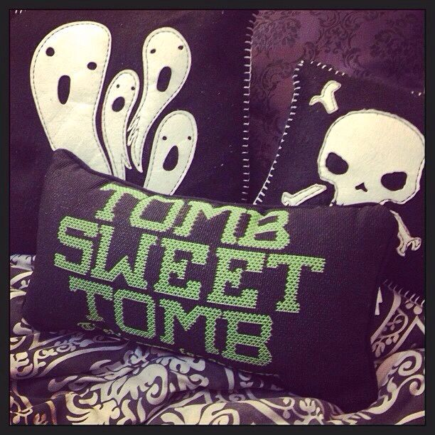 I have that skull pillow!  It glows in the dark!