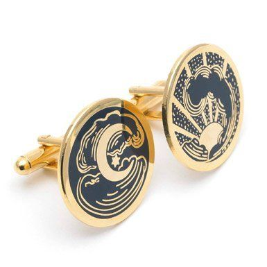 From the Victoria and Albert Museum gift shop: night and day cufflinks.