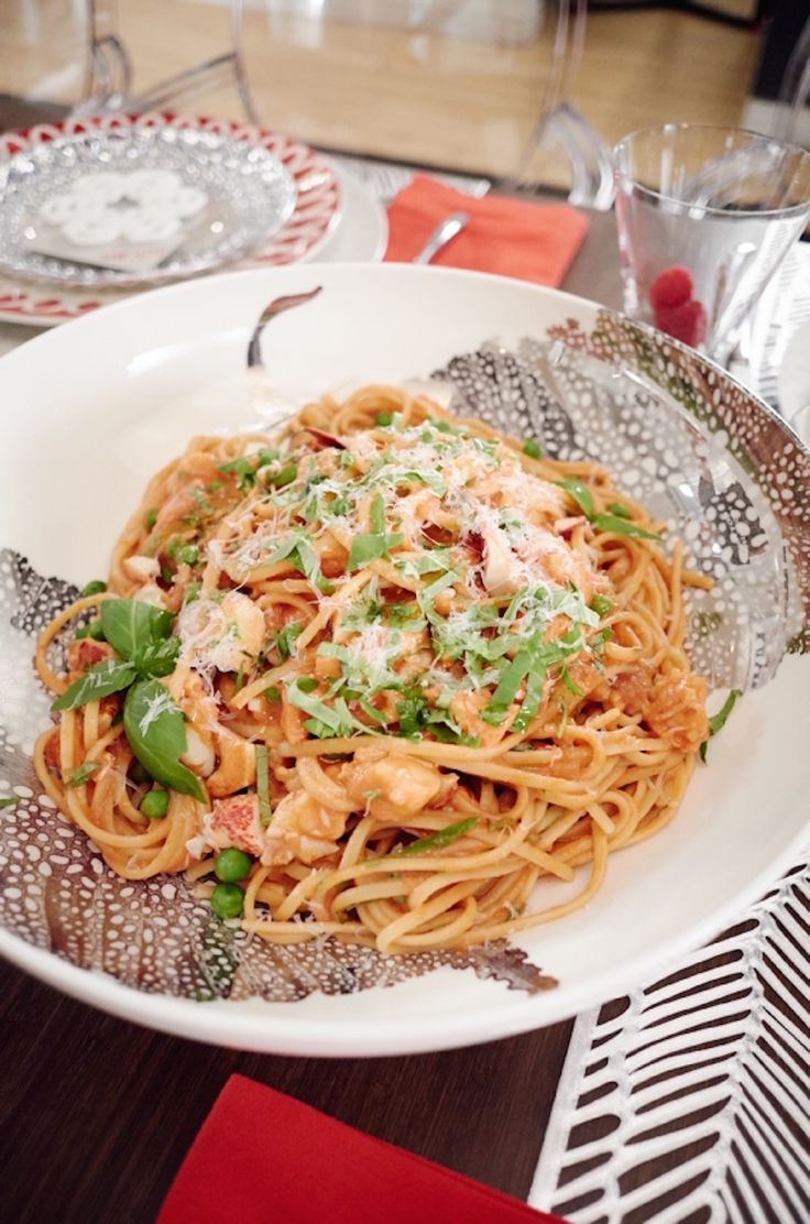 Linguine and steamed lobster tossed in a light cream sauce and topped with parmesan and arugula