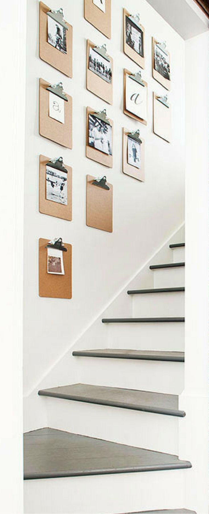 Hang clipboards on the wall for an easy photo gallery. You can switch out new photos whenever you want, display your kids' artwork, and more! Love this DIY home decor idea.