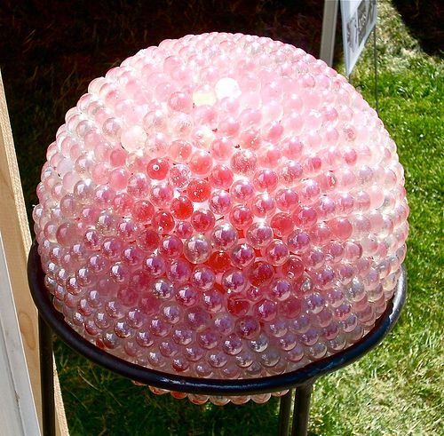 How to make marble garden art with bowling balls, lamp globes, or soccer balls.  Going to make one of these to replace the gazing ball my son broke. . .looks a little more durable