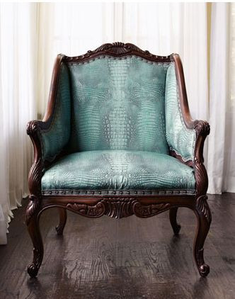 """Turquoise Chair - $3,000.00  Crocodile embossing and a brilliant shade of turquoise make this chair quite the stand-out. Beechwood frame from Italy has """"wormhole"""" accents."""