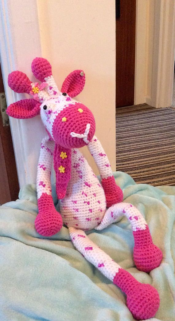 This Gorgeous little Giraffe measure's 69cm in length, from the top of her horn's to her toe's. She is made with beautiful acrylic blend pink and white multi yarn, stuffed with hypoallergenic stuffing and I have used black safety eye's. She has a beautiful pink scarf, which is