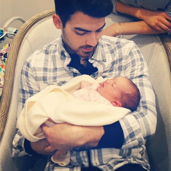 """The Jonas clan introduced their newest member baby Alena Rose, daughter of Kevin. She may be cute and all that but just look how cute Uncle Joe Jonas looks holding her.  New Uncle was shown cosying up for Alena for the very first time after her birth last week.  """"Welcome to this world Alena Jonas. #littlebaby #shessosmall #woah,"""" he wrote on his Instagram.  Congrats!"""