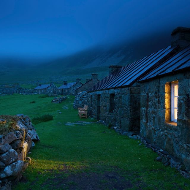 Night on St. Kilda in the Atlantic west of the Outer Hebrides of Scotland. This is the village that the islanders abandoned in 1930 when they just couldn't go on. It's now a UNESCO World Heritage site, cared for by the National Trust for Scotland. Several of the houses have been restored to provide housing for Trust workers. I stayed in this one, while it rained for a week and I read the haunting tale of the people of St. Kilda. @natgeo @natgeocreative #scotland #hebrides
