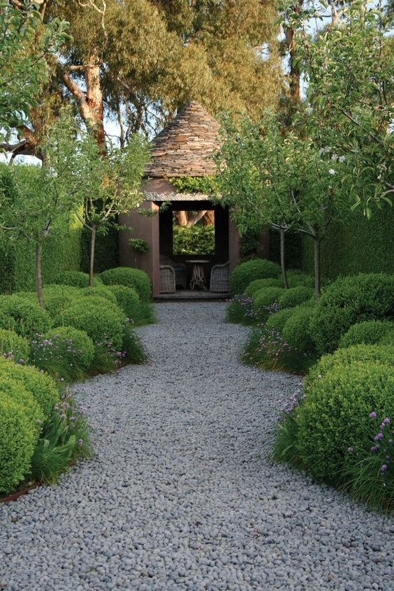 Rosemary bushes and olive trees lead down the path to a darling cottage..