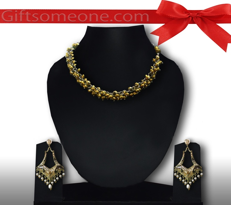 Rs.1,430.00 / $25.74 Shipping Charges Free Shipping To India(IND) Product Details  A trendy jewelry/ jewellery set in sparkling tarnish golden color, with the unique minakari danglers add a great charm to your personality. http://www.giftsomeone.com/product_info.php?products_id=3646