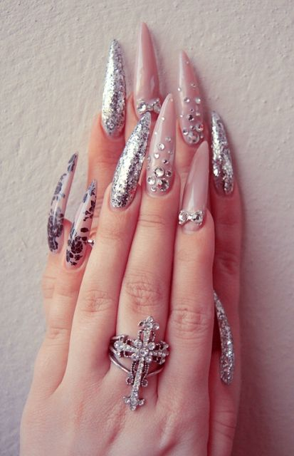 http://www.designideaz.com/beautiful-long-stiletto-shape-nails-ideas/