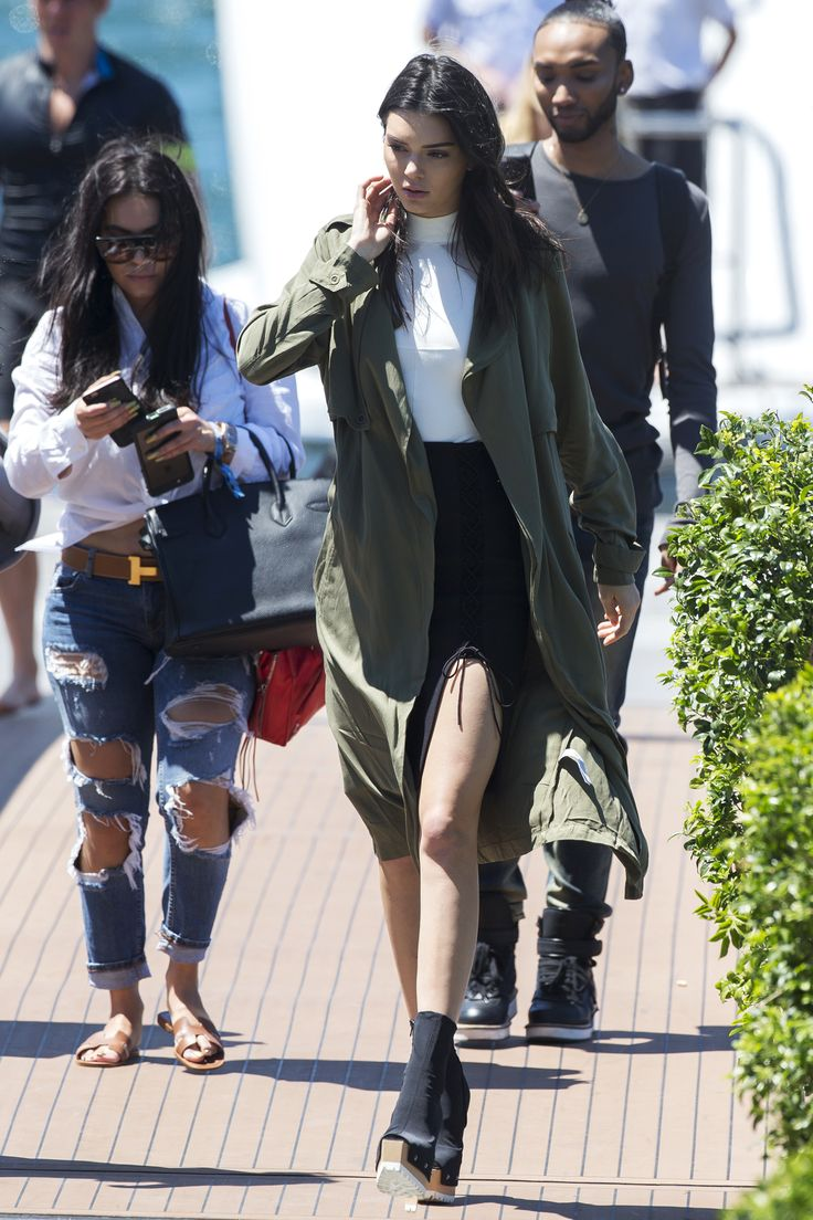 While touching down in Australia, the model completed her look with an olive Forever 21 trench jacket, which you can shop for less than $50 here.    - HarpersBAZAAR.com