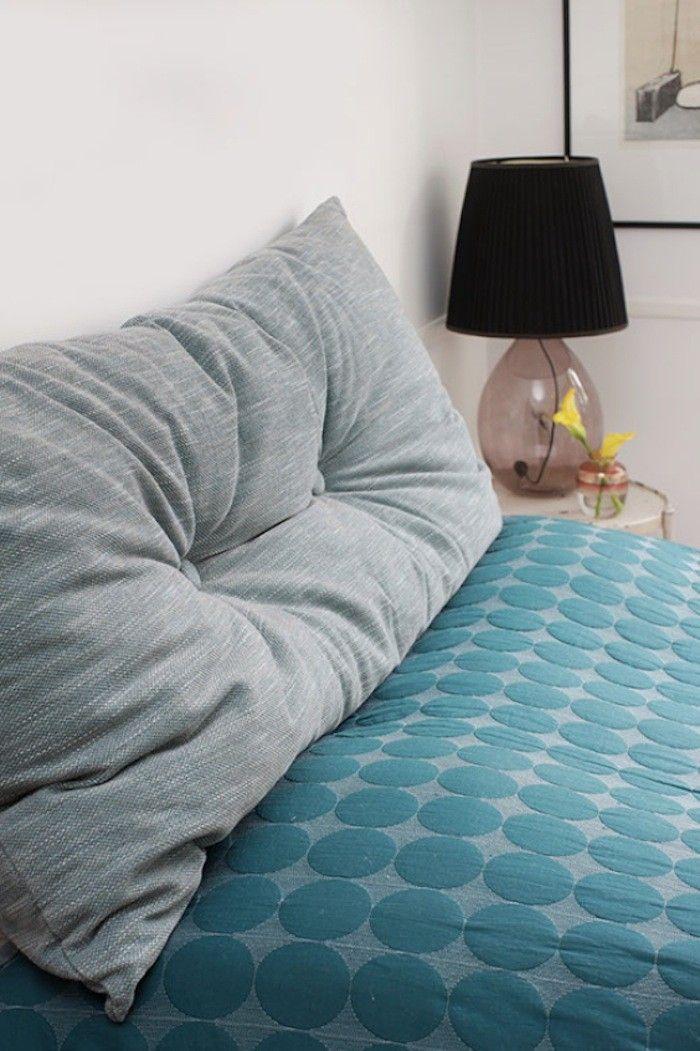Anne Mette Skodbor, Copenhagen home, gray cushion on teal blue bedspread
