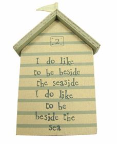 """East of India beach hut wall plaque.  Has the quote """"I do like to be beside the seaside, I do like to be beside the sea"""".  That is so true"""