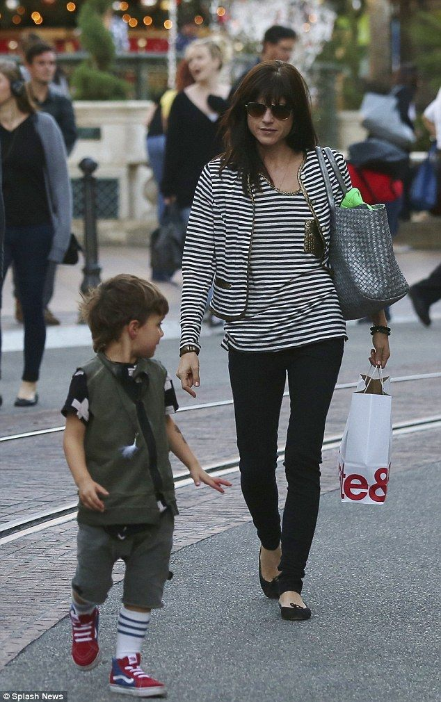 Doting mother: The brunette raises four-year-old Arthur with her ex-boyfriend Jason Bleick...
