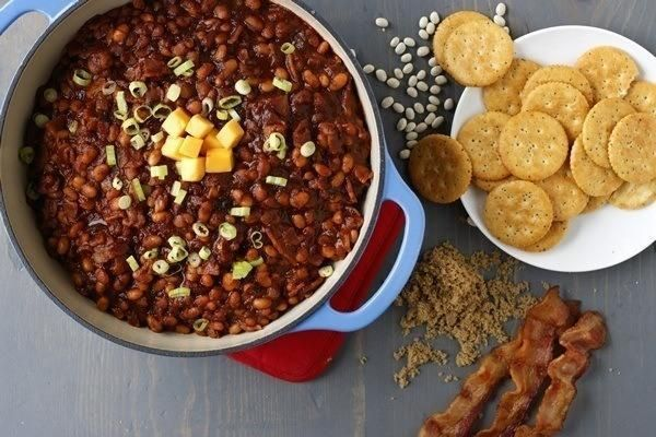 Celebrate Boston's best with sports, beer, and this baked bean dip using a crisp Boston lager. Pair this dip with crackers and top with Cheddar cheese and sour cream.Recipe courtesy of McCormick.