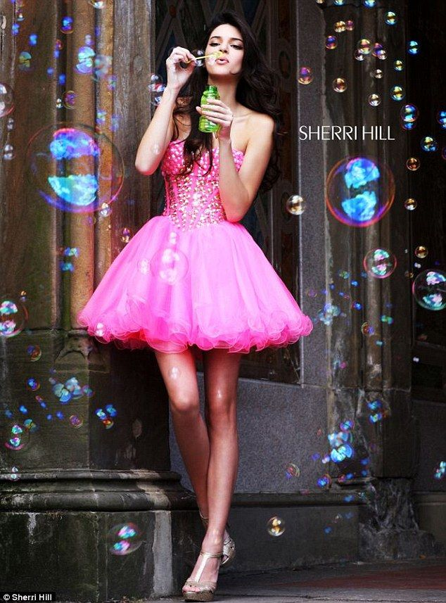 Bubbly: The leggy teen posed in a bubble-gum pink mini dress with a tulle skirt
