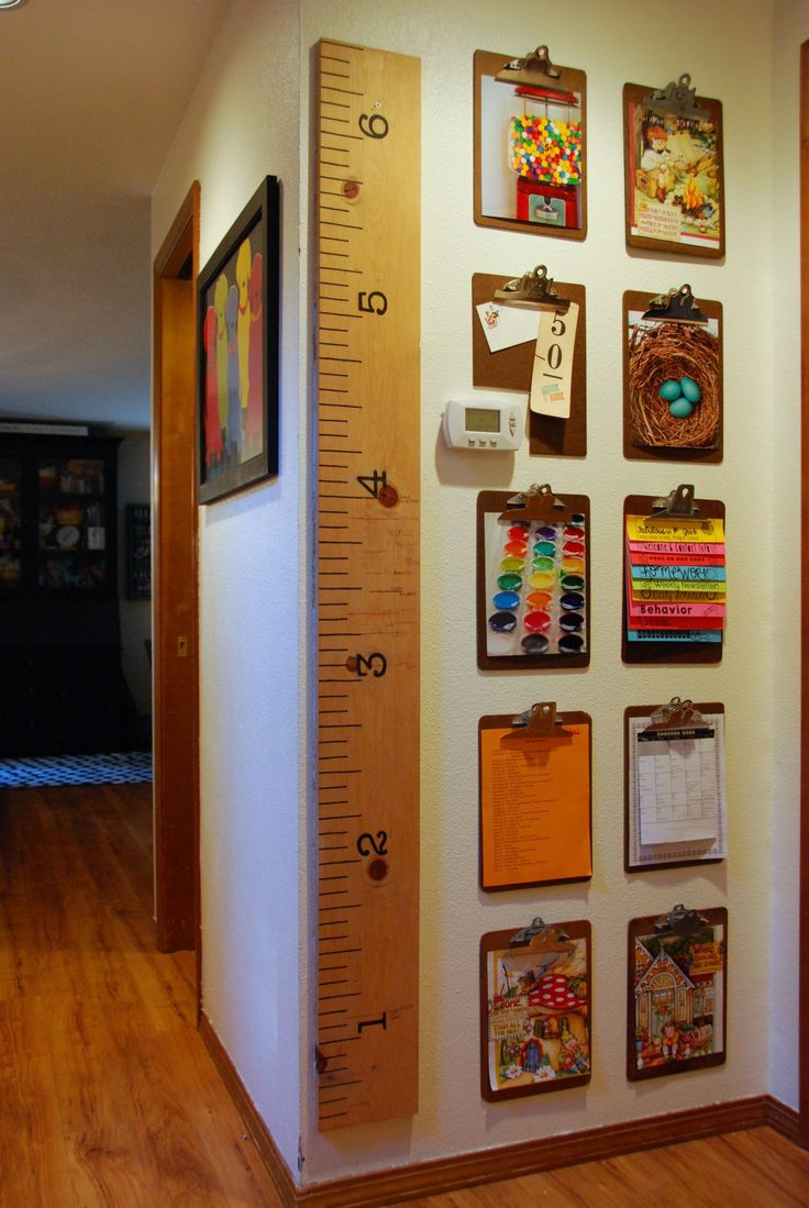 Second-hand clipboards create a gallery wall for kids artwork, calendars, photos, and anything else you might want to display or need access to. And an oversize ruler serves as a growth chart you can take with you should you move.
