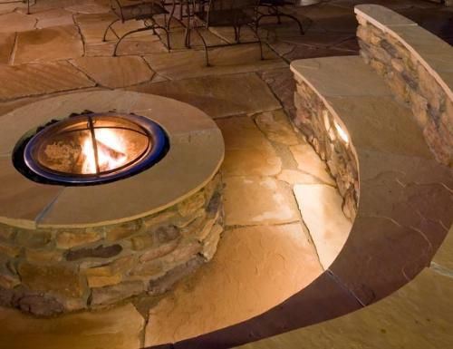 Perfect Patio - The built-in stone firepit fits perfectly in the corner of this stone patio. Under the seat lighting means you can enjoy this space at any time of the day!