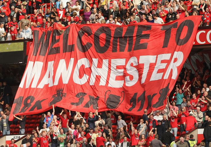 Manchester United fans extend a warm welcome to our blue neighbours before the Manchester derby in 2009.
