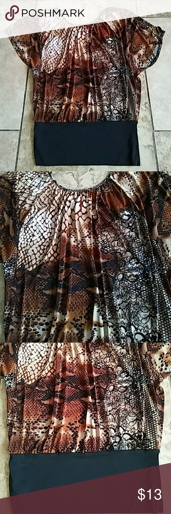 Womens sz.L luna tikis animal print blouse!! Womens size large sexy animal print luna tikis brand blouse in like new condition. It is loose fitted with tighter bottom black waist. Thanks Tops Blouses
