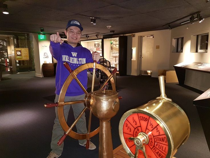 This Guy Standing In Front Of A Ship's Wheel