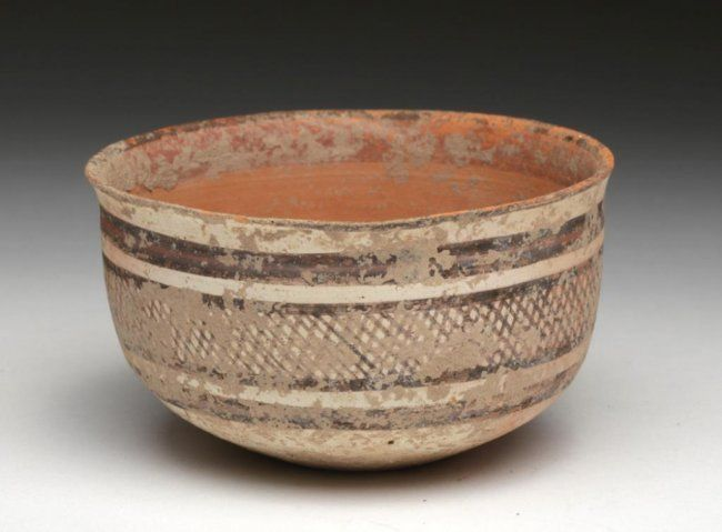 Indus Valley pottery jar, Pakistan, 3rd millenium B.C. Simple rounded form on flattened base, decorated with lines and net pattern, 8 cm diameter. Private collection