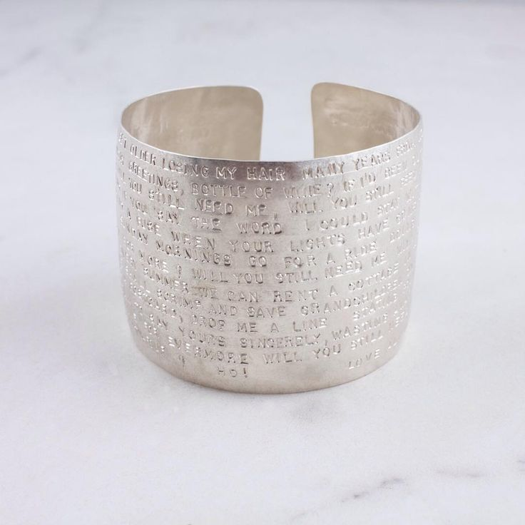 An entire love song stamped on our hammered wide cuff😍