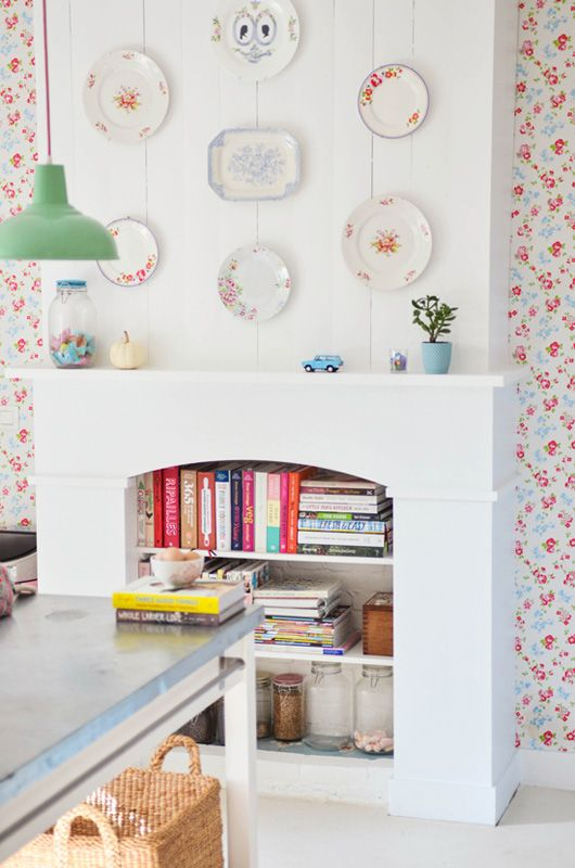 """A faux fireplace with bookshelves? Sweet! This could work as at least a place to put a drink when sitting in the armchairs that will be right in front of the """"fauxplace"""" in my studio apt too conservative of space to have end tables."""