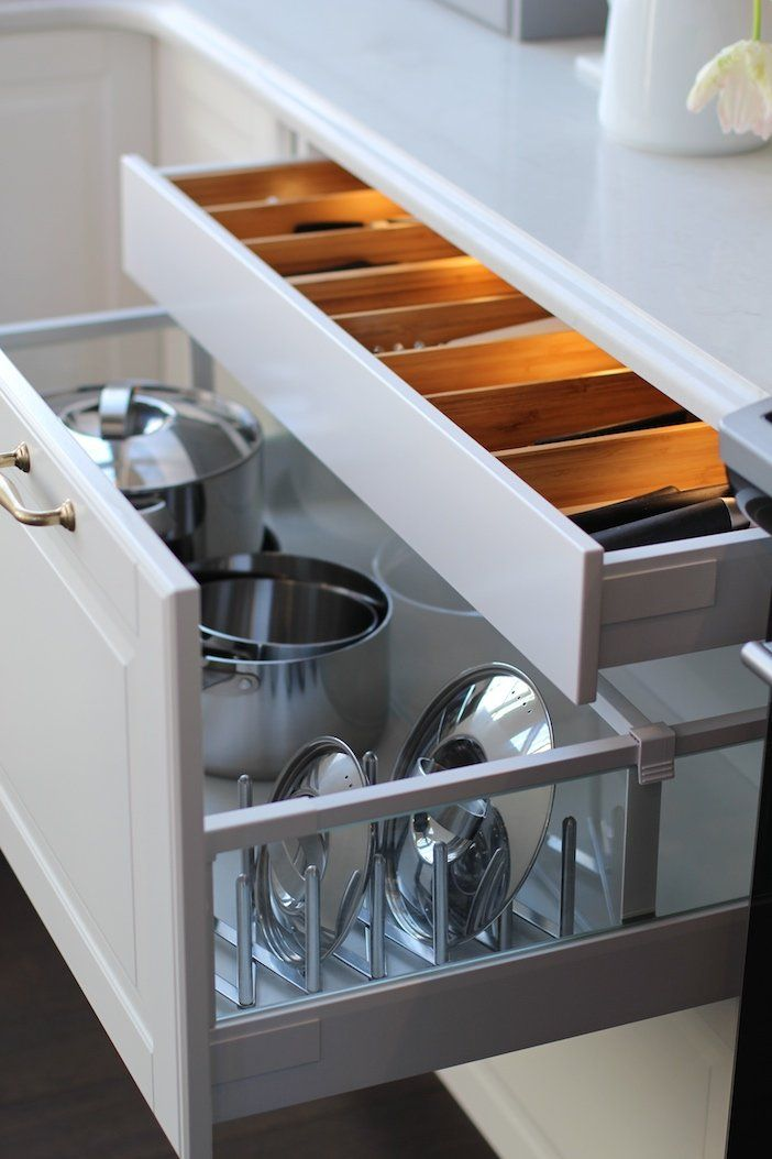 Pot and pan lids are notoriously tricky to organize, which is why this Ikea Sektion lid organizer is a must.