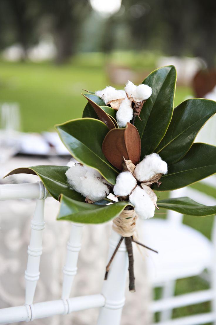Cotton & Magnolia leaves in a mason jar tied with straw, burlap or lace for simple centerpieces. 50th sign coming up through center