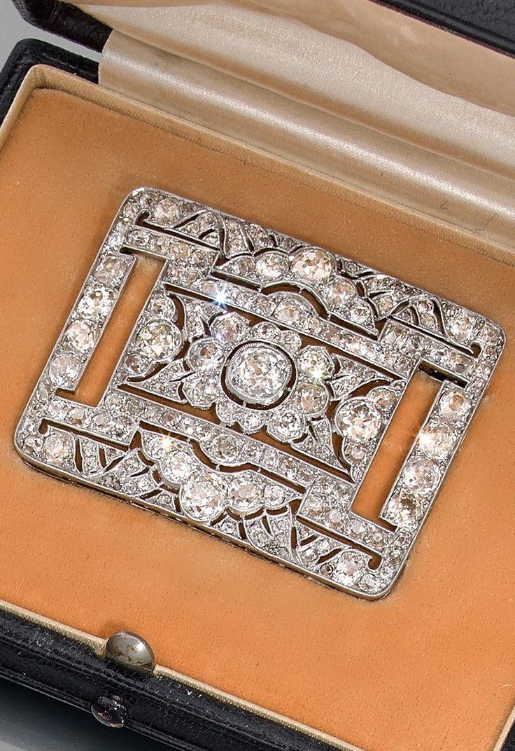 An Art Deco platinum, 18k gold and diamond, circa 1920. #ArtDeco #brooch