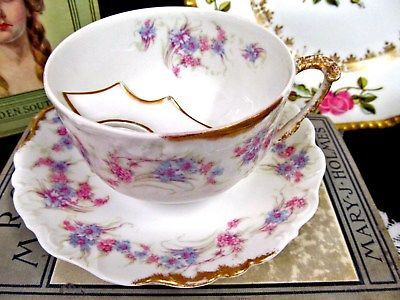 LIMOGES TEA CUP AND SAUCER MOUSTACHE MUSTACHE TEACUP FLORAL FANCY HANDLE