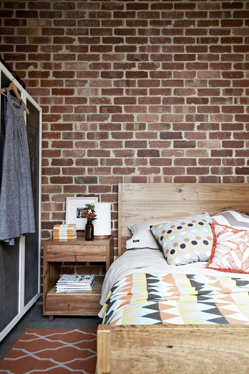 Bedroom with recycled timber bed and bedside table, rug from the Armadillo & Co Designer Collection, knitted blanket and cushion by local brand Uimi