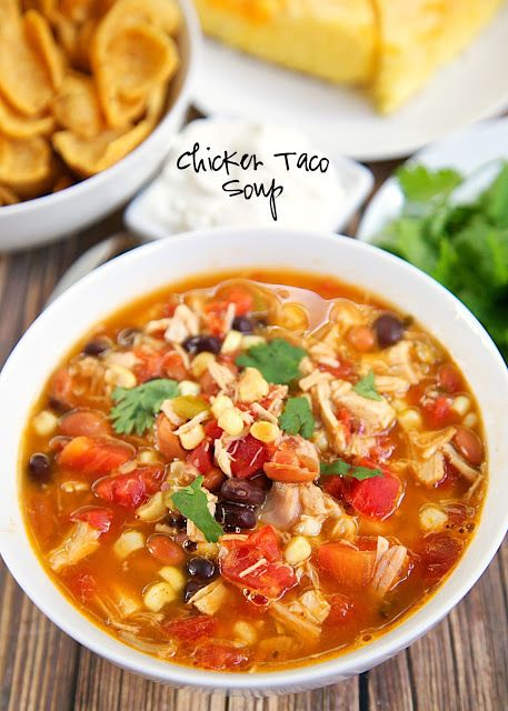 Chicken Taco Soup Recipe - Chicken, beans, corn, tomatoes, Ranch mix and taco seasoning. Can be made two different ways. On the stovetop with some rotisserie chicken or in the slow cooker with some boneless chicken breasts. Either way, it is super delicious and packed FULL of flavor! Serve with some cornbread for a delicious meal!