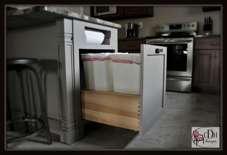 Hidden trash can storage gives me room for paper products and trash, without cluttering up my kitchen. A handy paper towel holder above makes clean-up easy with 3 kids!