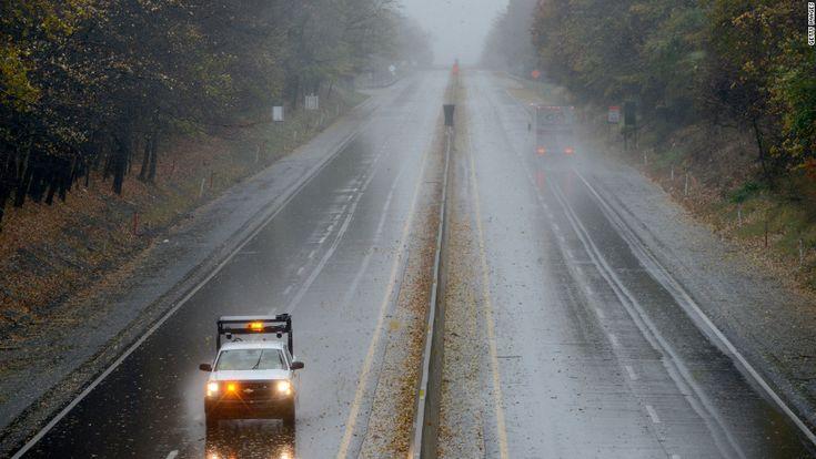 A Pennsylvania Department of Transportation truck slowly drives on the Pennsylvania Turnpike as Sandy approaches Bensalem, Pennsylvania, on Monday.