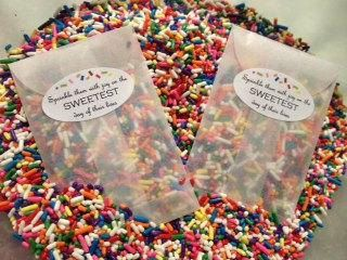 "Happening! ADORABLE TOSS IDEA!  And the envelope says… ""Sprinkle them with *joy?* on the SWEETEST day of their lives!  SUPER CUTE!"